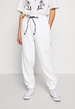DRAWCORD - Tracksuit bottoms - white