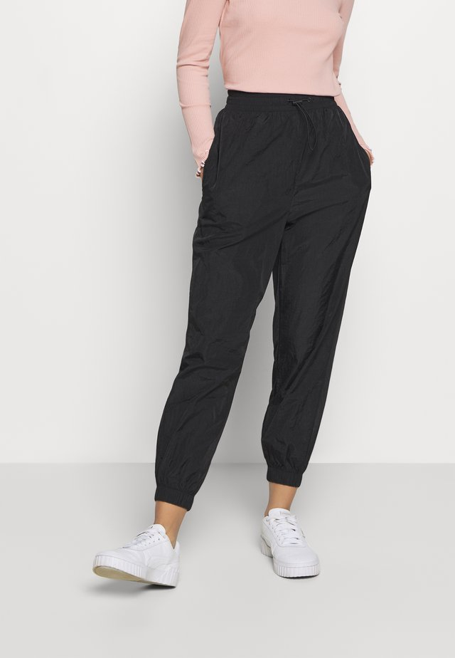 JOGGER - Jogginghose - black