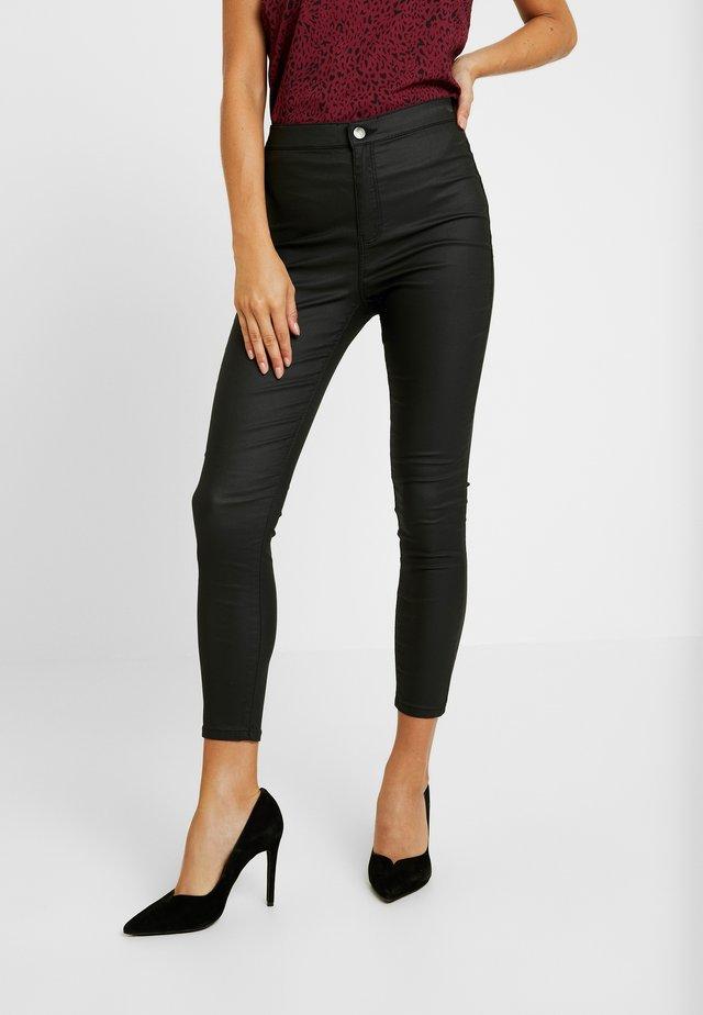 JONI - Spodnie materiałowe - black