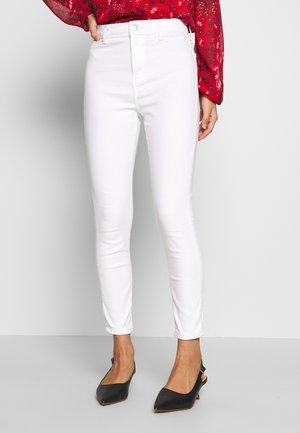 JONI CLEAN - Trousers - white