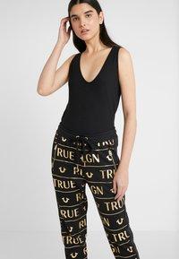 True Religion - PANTS - Tracksuit bottoms - black - 3