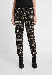 True Religion - PANTS - Tracksuit bottoms - black - 0