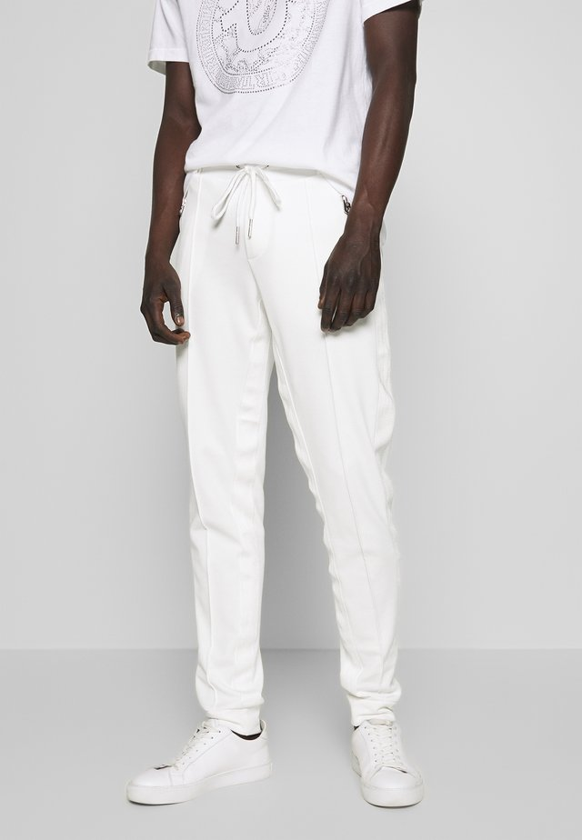 PANT - Tracksuit bottoms - milky white