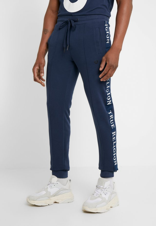 PANT STRIPE EMBRO - Tracksuit bottoms - dark blue