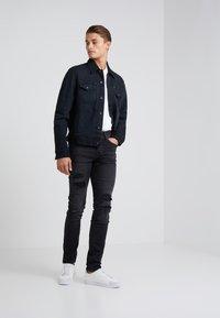 True Religion - ROCCO TRUEFLEX DESTROYED - Jeans slim fit - black - 1