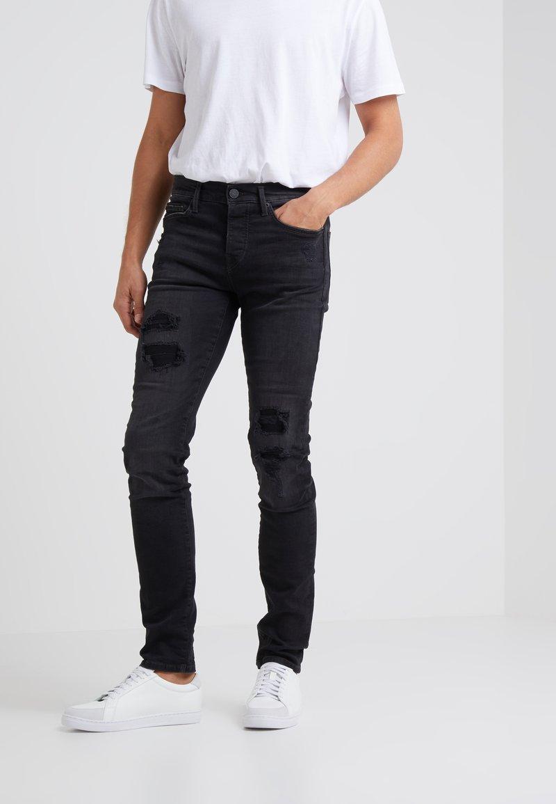True Religion - ROCCO TRUEFLEX DESTROYED - Jeans slim fit - black