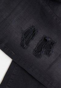 True Religion - ROCCO TRUEFLEX DESTROYED - Jeans slim fit - black - 4