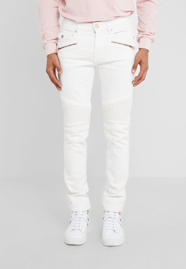 ROCCO BIKER - Slim fit jeans - white