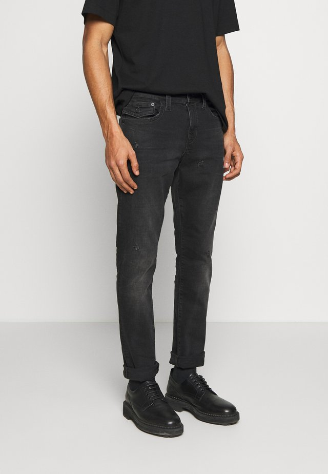 NEW GENO - Slim fit jeans - grey