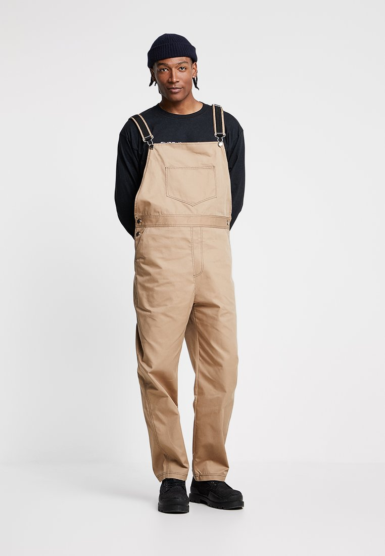 The Ragged Priest - DUNGAREE WITH STRAP DETAILING - Dungarees - camel/black