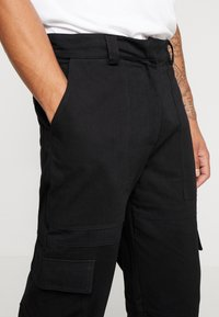 The Ragged Priest - COMBATS - Pantalon cargo - black - 5