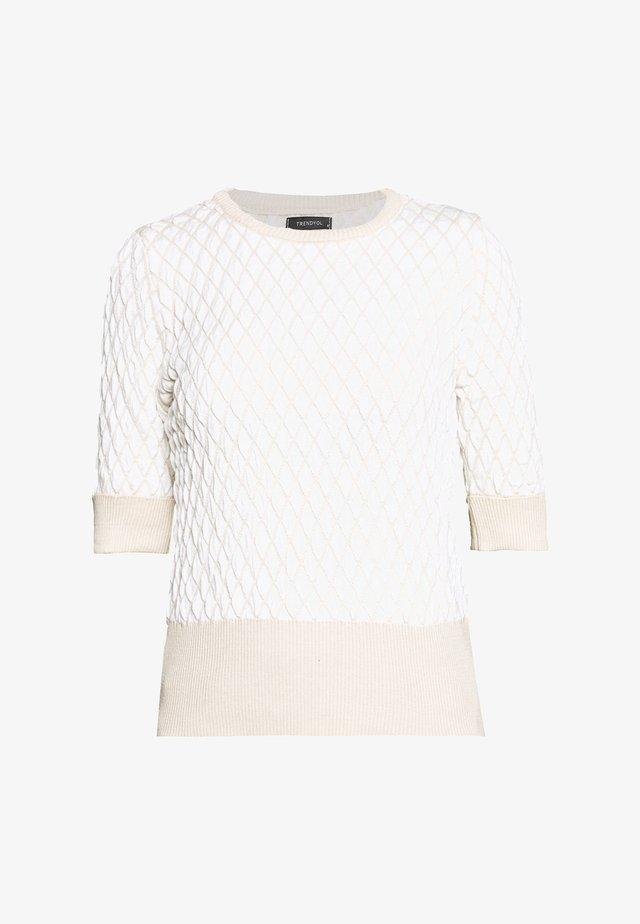 T-shirt med print - stone