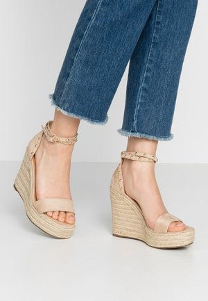 High heeled sandals - beige