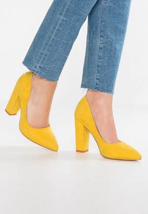 Høye hæler - yellow