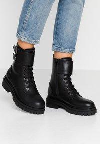 Tata Italia - Cowboy/biker ankle boot - black - 0