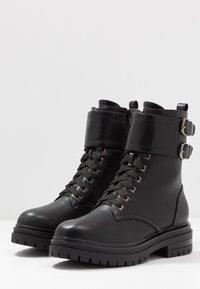 Tata Italia - Cowboy/biker ankle boot - black - 4