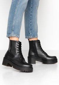 Tata Italia - Kotníkové boty na platformě - black - 0