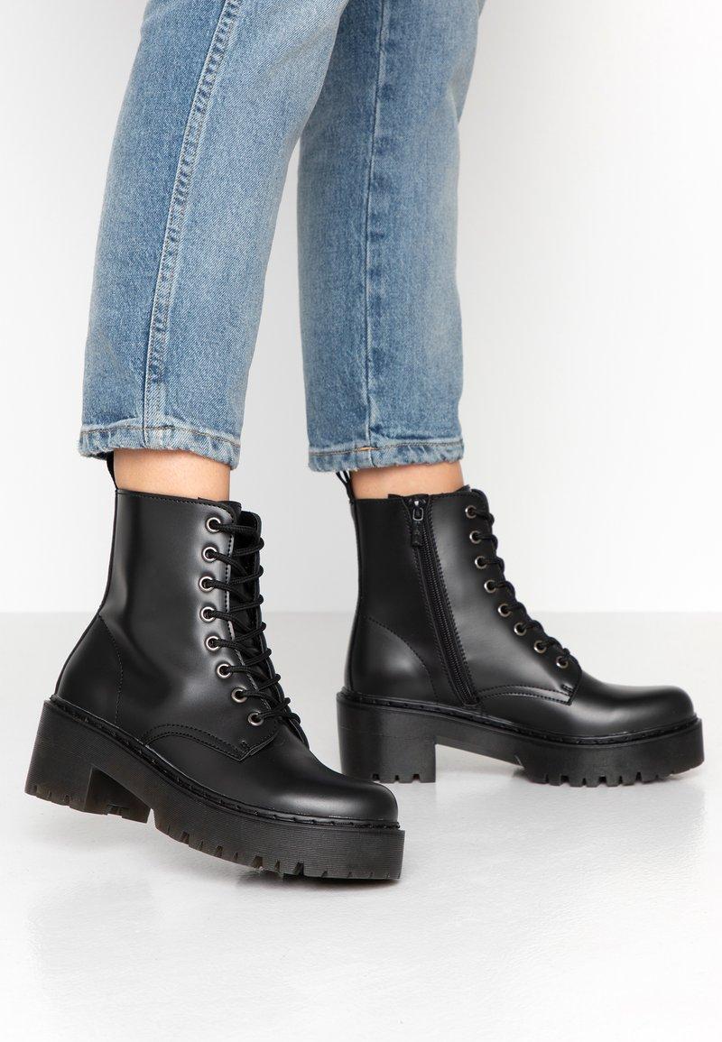 Tata Italia - Kotníkové boty na platformě - black