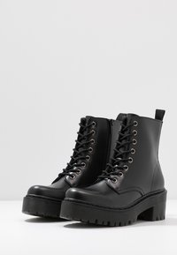 Tata Italia - Kotníkové boty na platformě - black - 4