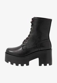Tata Italia - Kotníkové boty na platformě - black - 1