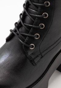 Tata Italia - Kotníkové boty na platformě - black - 2