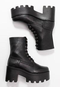 Tata Italia - Kotníkové boty na platformě - black - 3