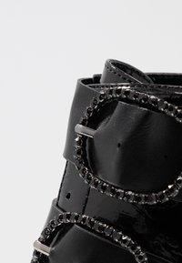 Tata Italia - Kotníkové boty - black - 2