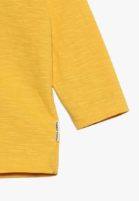 Tumble 'n dry - BABY - Long sleeved top - yolk yellow - 2