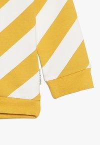 Tumble 'n dry - JONNE BABY - Mikina - yolk yellow - 2