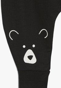 Turtledove - BEAR HEAD HAREMS BABY - Pantalones - black - 3