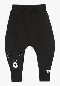 Turtledove - BEAR HEAD HAREMS BABY - Pantalones - black - 0