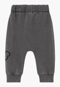 Turtledove - EMBROIDERED BADGE HAREMS BABY - Teplákové kalhoty - dark green - 1