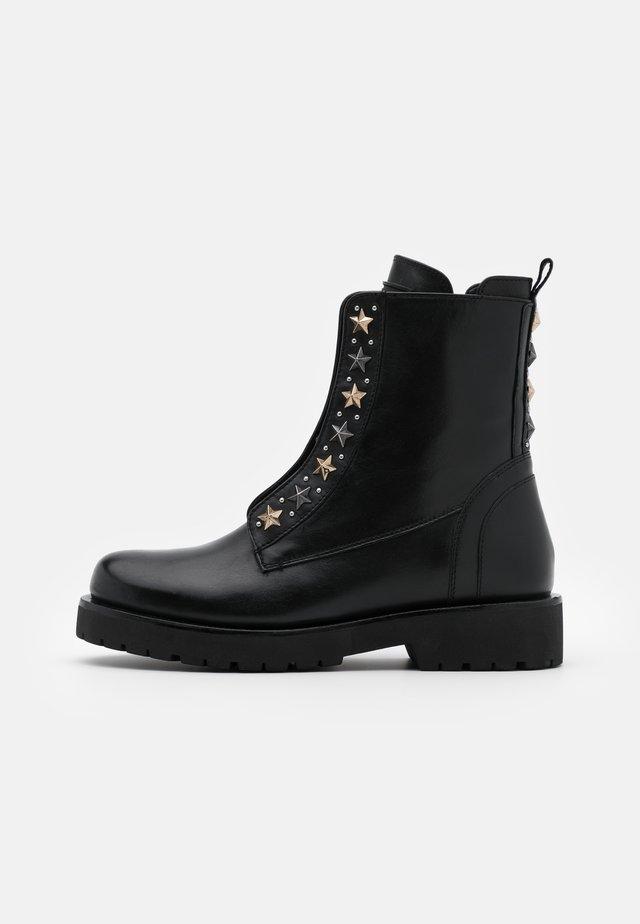 ANFIBIO BORCHIE - Platform ankle boots - nero