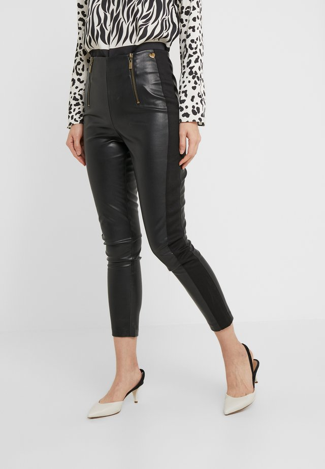 SIMILPELLE - Leggings - nero
