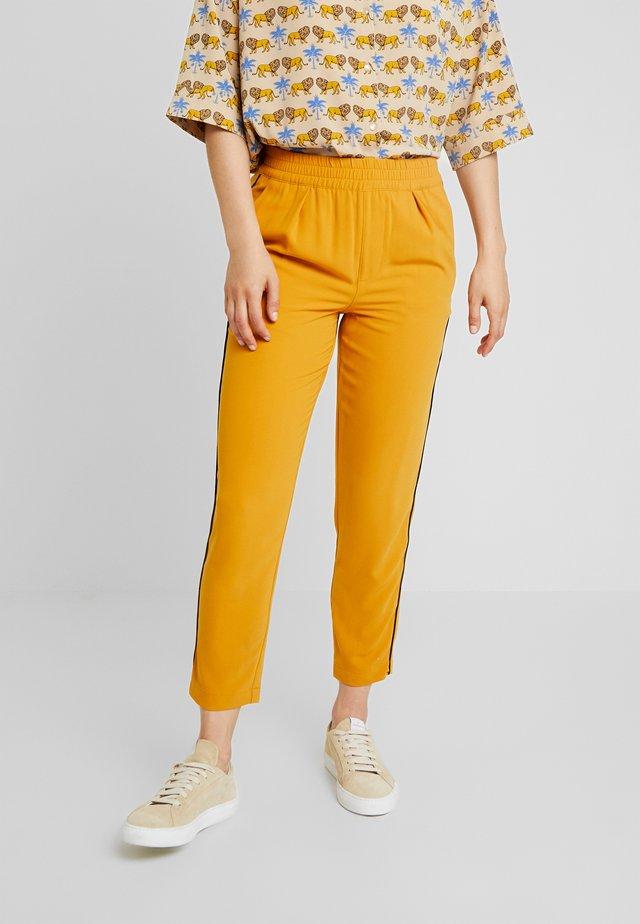 Spodnie materiałowe - mustard