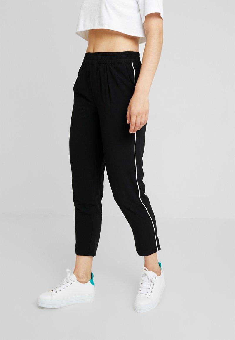 TWINTIP - Trousers - black