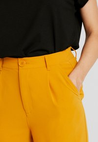 TWINTIP - Trousers - mustard - 4