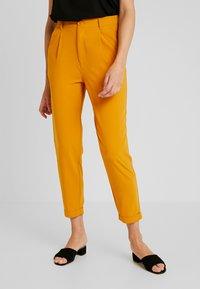 TWINTIP - Trousers - mustard - 0