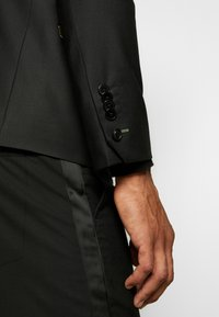 Twisted Tailor - VOLPI BLAZER - Suit jacket - black - 6