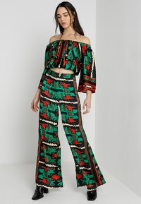 U Collection by Forever Unique - SET - Pantalon classique - green/red - 1