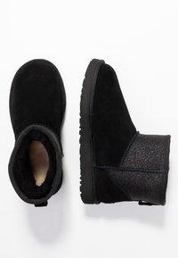 UGG - CLASSIC MINI SPARKLE - Winter boots - black - 3