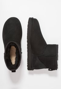 UGG - CLASSIC MINI - Classic ankle boots - black - 1
