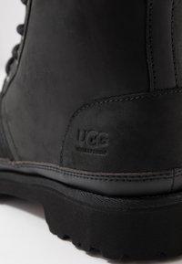 UGG - HARKLAND WP - Lace-up ankle boots - black - 5