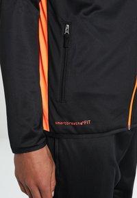 Uhlsport - ESSENTIAL CLASSIC - Tracksuit - schwarz/fluorescent orange - 6