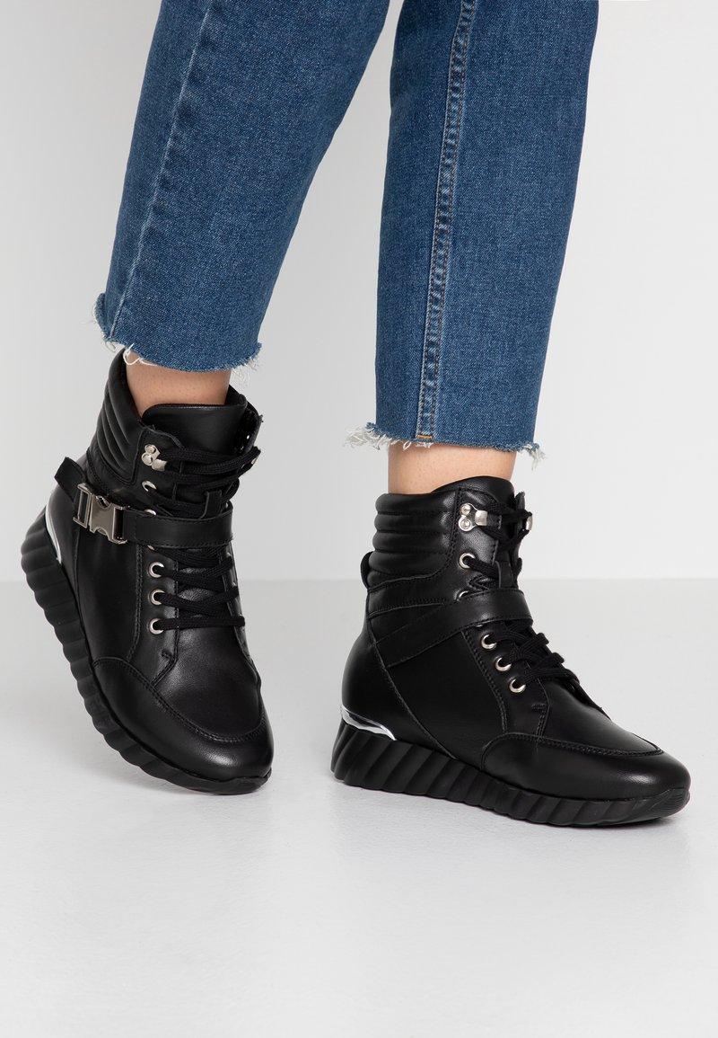 UMA PARKER - Lace-up ankle boots - nero