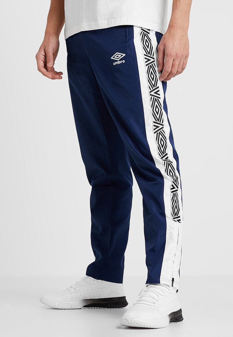 Umbro - SURF TRACK PANT - Tracksuit bottoms - medieval blue/white