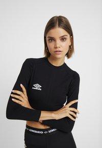 Umbro Projects - CARA CROPPED WOMEN - Top sdlouhým rukávem - stretch limo/bright white - 0