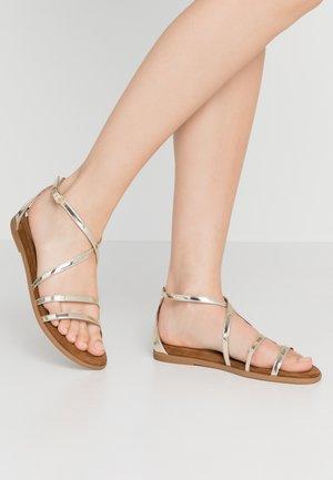 CIRILA - Sandaalit nilkkaremmillä - platino