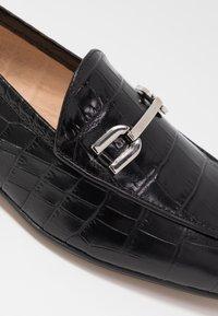 Unisa - DALCY - Slippers - black - 2
