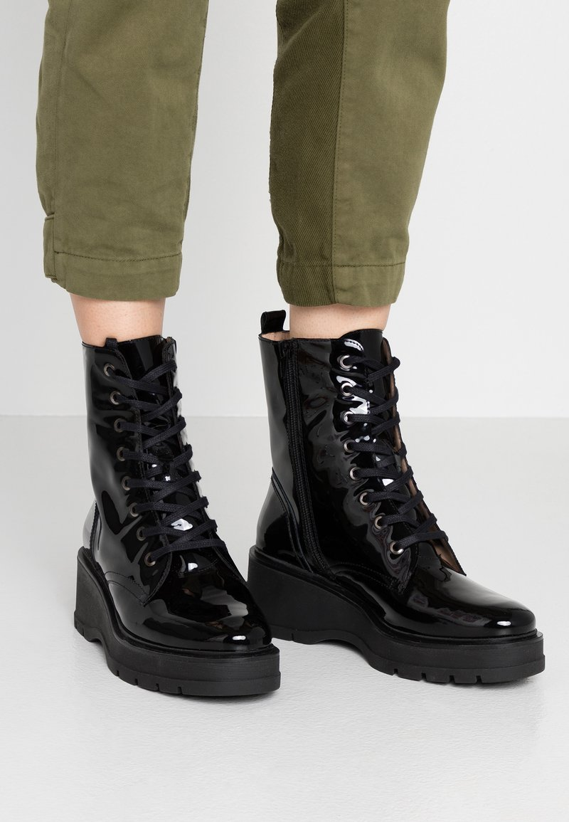 Unisa - GRYSO - Platform ankle boots - black